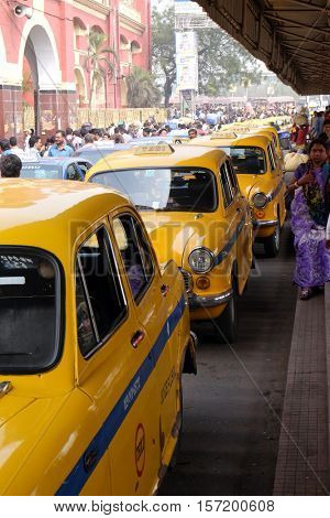 KOLKATA, INDIA - FEBRUARY 10: Yellow Kolkata taxis outside Howrah Railway Station in morning rush hour, Howrah, Kolkata, India on February 10, 2016.