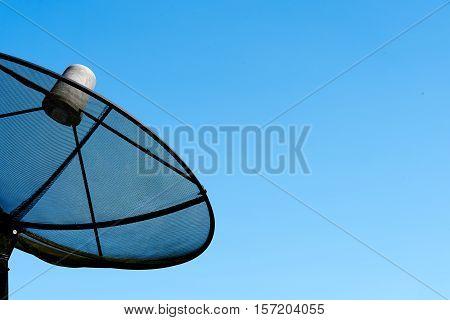 Satellite dish transmission data on background blue sky