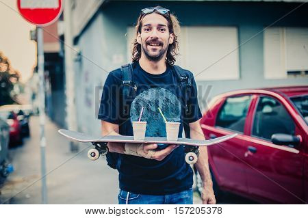 Skateboarder Make Fun And Brings Coffee On Skateboard