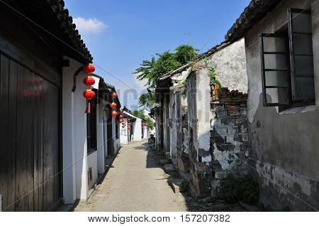 Weathered and old buildings lining the narrow alleyways in Luzhi Town in Jiangsu province China