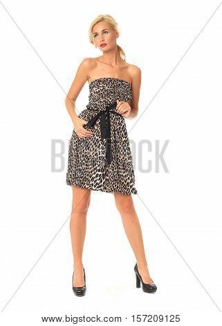 Full Length Of Flirtatious Woman In Leopard Dress Isolated On White