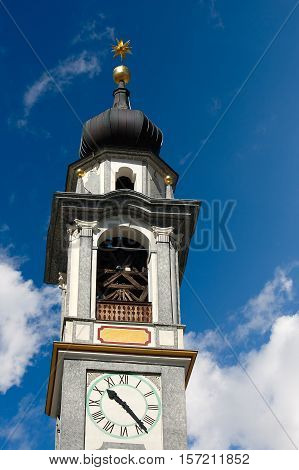 Detail of the bell tower of the Evangelical Reformed Church in Samedan small town in Engadine Switzerland Europe
