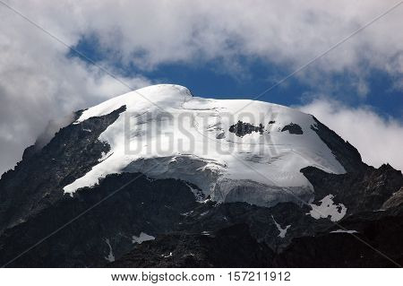Detail of the glacier of Bernina in Swiss Alps in summer with cloudy sky. Engadine Switzerland Europe