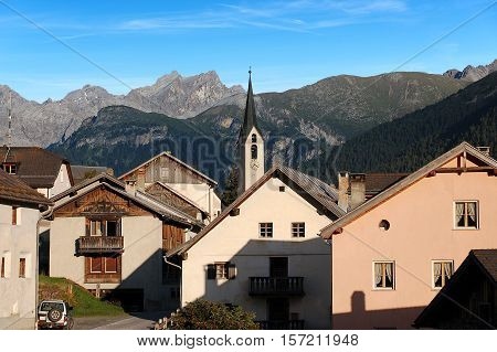 The small ancient village of Guarda with the Swiss Alps. Scuol Engadine Switzerland Europe