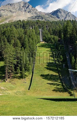Ski jump area (springboard) in summer. Swiss Alps in Saint Moritz Engadin Switzerland Europe