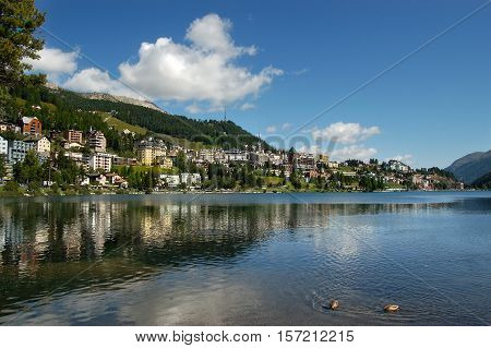 Cityscape of Saint Moritz with lake blue sky and clouds. Engadin Switzerland Europe