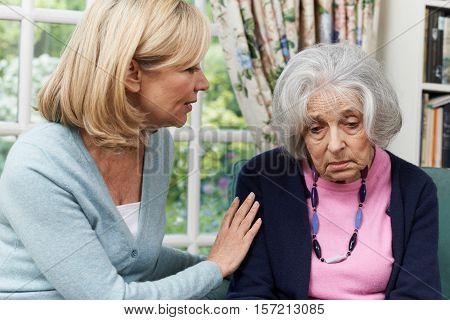 Mature Female Friend Comforting Unhappy Senior Woman