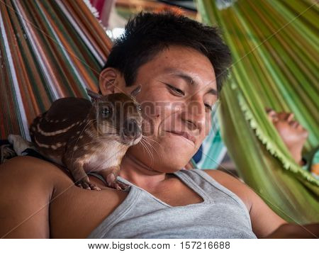 Red-skin Man With Exotic Animal