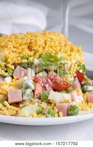 Salad of diced ham eggs green peas salad leaves dressed with yogurt