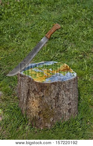 Machete permeates the planet by cutting down the forest nature protection concept
