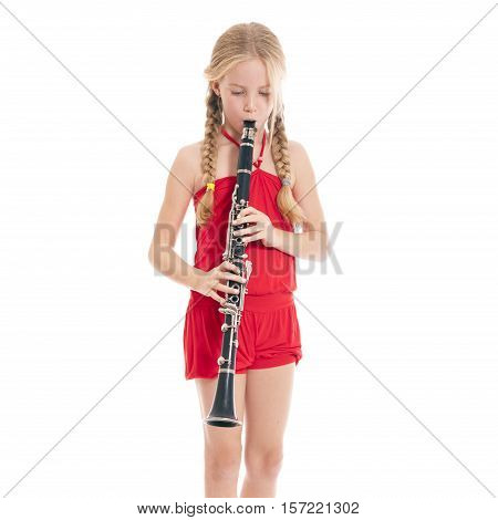 square picture of young girl in red playing the clarinet against white background