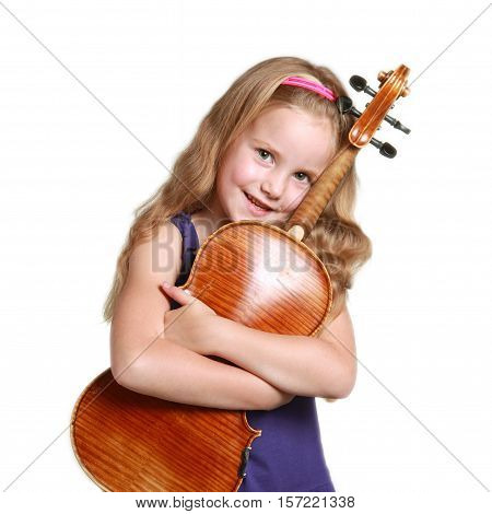 square picture of little girl in purple dress huggs violin against white studio background