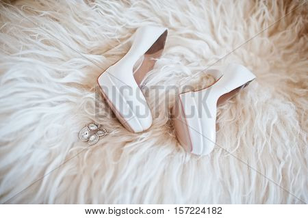 Bride Wedding Shoes With High Heels And Silver Brilliant Earrings On Sheep's Clothing