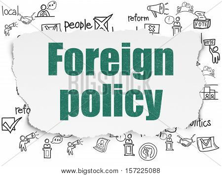 Political concept: Painted green text Foreign Policy on Torn Paper background with  Hand Drawn Politics Icons