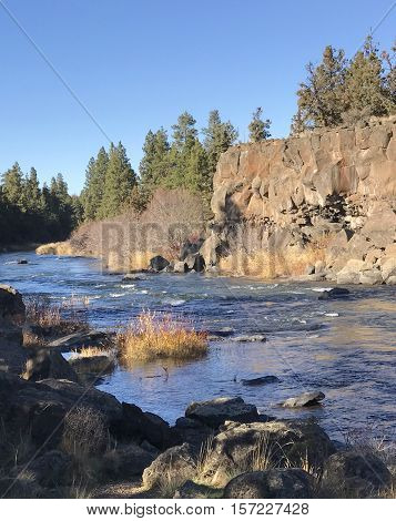 The Deschutes River leaves a canyon in Sawyer Park in Central Oregon in a sunny fall day.