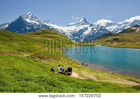 People Looking At Bachsee, Alps, Switzerland