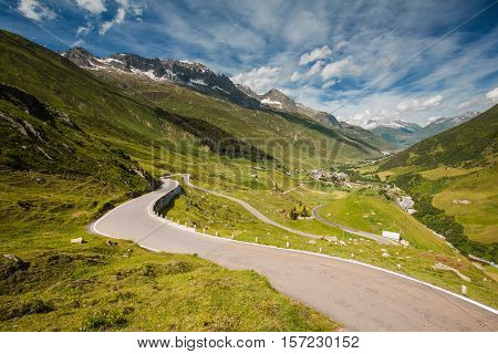 View Of Road From Furka Pass, Realp City Below