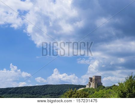Landscape Image, Ruins of a castle in Csesznek, Veszprem, Hungary with Blue Sky and Clouds