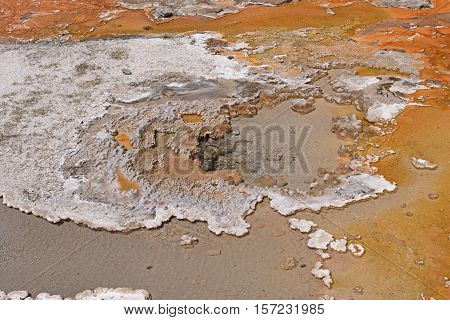 Colorful Thermal Pool in the Wilderness of the Shoshone Basin in Yellowstone National Park in Wyoming