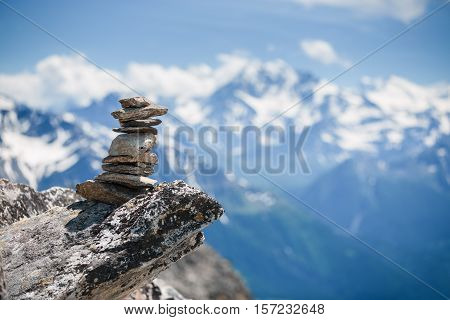 Stones Cairn Near Eggishorn Peak In Swiss Alps