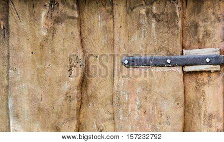 Old Wooden Door and Door Hinge Close up