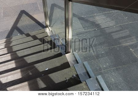 Contemporary stairway detail with steel and glass banister