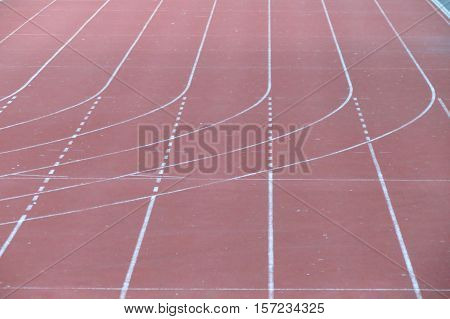 All-weather running track perspective useful as sport or competition concept