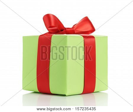 small green gift box with red ribbon bow isolated on white background