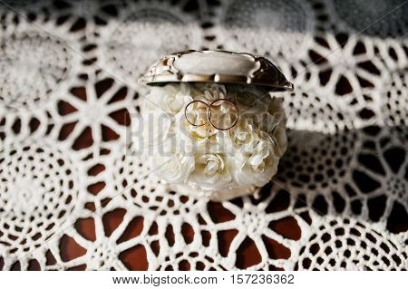 Wedding Rings On Casket Of Jewels With Small Rosses Inside.