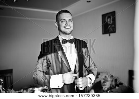 Portrait Of Stylish Young Beard Man, Wearing Luxury Jacket And Bow Tie. Gathering Of Groom On Weddin