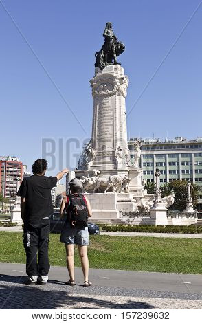 LISBON, PORTUGAL - September 30, 2016: People looking at the monument to the Marquis of Pombal in Lisbon Portugal