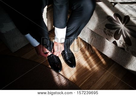 Man Wearing Luxury Patent Leather Shoes On Sunlight With Shadows. Gathering Of Groom On Wedding Day.