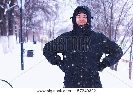 young student in a winter landscape on a sunny nice day