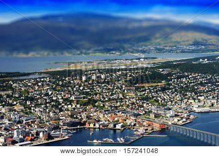 Tilt-shifted micro toy Tromso city with bridge background hd