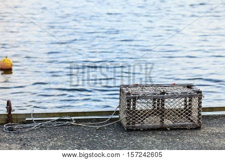 Fish trap cages for trapping aquatic animals crabs in port on sea shore.