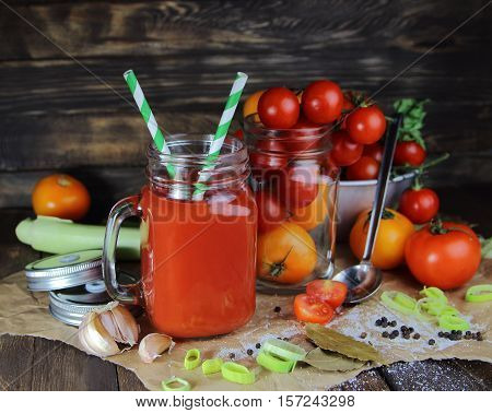 tomato juice in a mug with fresh tomatoes and spices