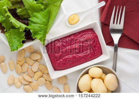 Delicious beet dip sauce with potatoes and almonds.