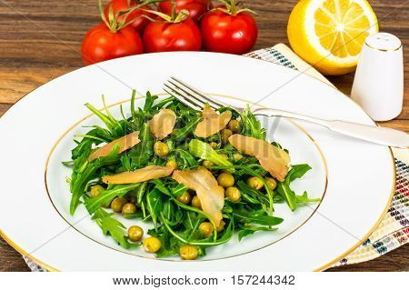 Salad with Arugula, Peas, Jerked Chicken, Mix of Peppers and Vegetable Oil Studio Photo