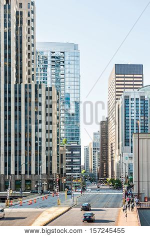 Chicago, USA - May 30, 2016: View of Wacker Drive with bridge, skyscrapers, people and cars in downtown