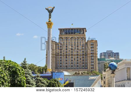 Kiev, Ukraine - May 25, 2013: Maidan Nezalezhnosti or Independence Square in downtown with monument, before Euromaidan took place, and tall hotel Ukraina building with flag