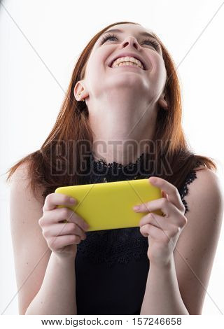 Happy Woman With A Yellow Mobile Phone