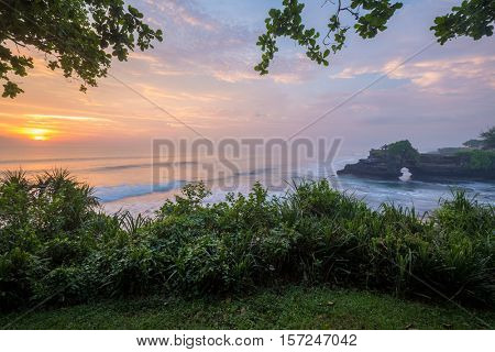 Sunset in the ocean at the Tanah Lot Temple, Bali, Indonesia