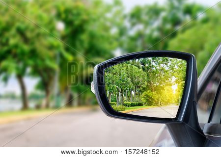 side rear-view mirror on a car in park