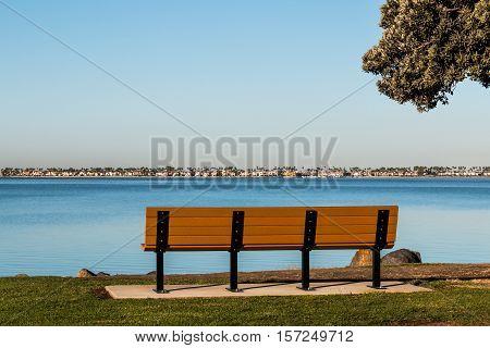Bench and tree branches at Chula Vista Bayfront Park facing San Diego bay.