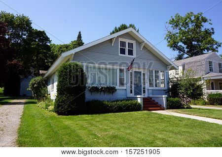 HARBOR SPRINGS, MICHIGAN / UNITED STATES - AUGUST 3, 2016: A brick and stucco home near the Zorn Park Beach in Harbor Springs.