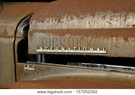 MANDAN, NORTH DAKOTA, July 1, 2016: The old pickup with an open hood and International logo is a product of the International Harvester Company which was a United States manufacturer of agricultural machinery, construction equipment, trucks, and  formed I