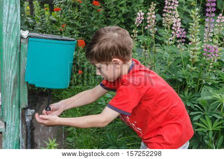 The boy in the village of washes outdoors