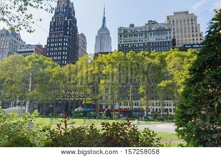 NEW YORK CITY-SEPT 22 2012: Daily attendance in Bryant Park counts often exceed 800 people per acre making it the most densely occupied urban park in the world. New York September 22 2012