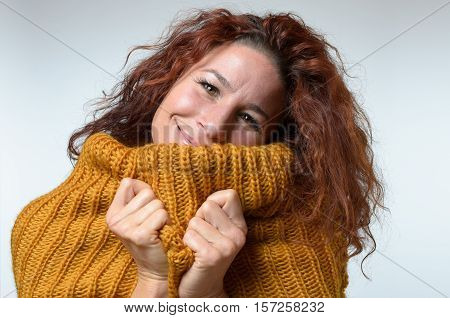 Warm Happy Woman Snuggling Into A Winter Jersey