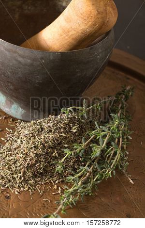 Antique Metallic Mortar With Dried And Fresh Thyme.